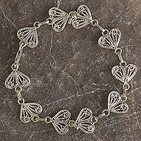 Sterling silver filigree bracelet, 'Hearts' - Floral Filigree Handmade Silver Heart Bracelet from Mexico