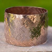 Rose gold plated bangle bracelet, 'Chuspata Charm' - Hand Woven Pink Gold Plated Copper Bangle Bracelet