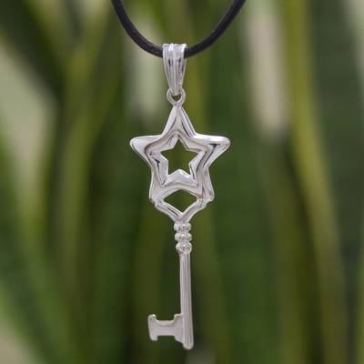 Sterling silver pendant necklace, 'Key to the Stars' - Silver Key Pendant Black Leather Necklace from Mexico