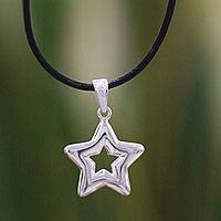 Sterling silver pendant necklace, 'Stellar' - Sterling Silver Star Pendant Necklace Black Leather Cord