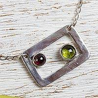 Peridot and garnet pendant necklace, 'Adrift' - Modern Peridot and Garnet Necklace in Sterling Silver