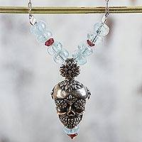 Garnet and quartz flower necklace, 'Cempazuchitl Skull' - Day of the Dead Silver Necklace with Garnet and Aquamarine