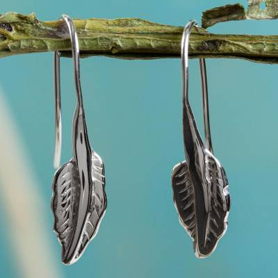 Sterling silver drop earrings, 'Windblown Leaf' - Artisan Crafted Mexican Silver Leaf Theme Earrings