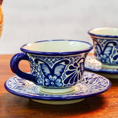 Ceramic cups and saucers, 'Cholula Blossoms' (pair) - Mexican Blue Talavera Style Ceramic Cups and Saucers (Pair)