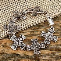 Sterling silver link bracelet, 'Aztec Calendar Stone' - Sterling Silver Link Bracelet with Aztec Motifs Mexico