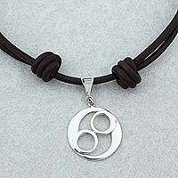 Sterling silver pendant necklace, 'Omelotl' - Taxco Sterling Silver and Leather Pendant Necklace