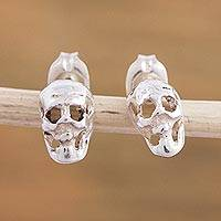 Sterling silver stud earrings, 'Shimmering Skulls' - 925 Sterling Silver Skull Stud Earrings from Mexico
