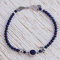 Beaded lapis lazuli pendant bracelet, 'Night Flight' - Blue Lapis Lazuli Beaded Bird Bracelet from Mexico