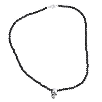 Sterling silver pendant necklace, 'Skull Between the Stones' - Sterling Silver and Lava Stone Skull Necklace from Mexico