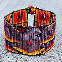 Glass beaded wristband bracelet, 'Eagle Flight' - Eagle-Themed Glass Beaded Wristband Bracelet from Mexico