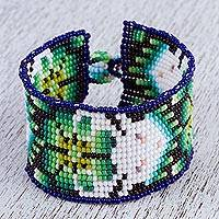Glass beaded wristband bracelet, 'Sacred Deer' - Deer Motif Glass Beaded Wristband Bracelet from Mexico