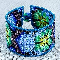 Glass beaded wristband bracelet, 'Blue Deer' - Glass Beaded Bracelet with Deer Motifs from Mexico
