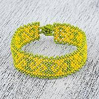 Glass beaded wristband bracelet, 'Poise and Tradition' - Glass Beaded Bracelet in Yellow and Green from Mexico