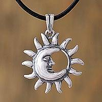 Sterling silver pendant necklace, 'Embraced by the Sun' - Sterling Silver Sun and Moon Eclipse Leather Cord Necklace