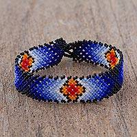 Glass beaded wristband bracelet, 'My Blue Sky' - Floral Glass Beaded Wristband Bracelet in Blue from Mexico