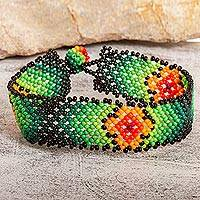 Glass beaded wristband bracelet, 'My Green Earth' - Floral Glass Beaded Wristband Bracelet in Green from Mexico