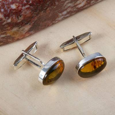 Amber cufflinks, 'Amber Harmony' - Men's Sterling Silver and Amber Oval Cufflinks from Mexico