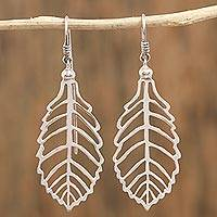 Sterling silver dangle earrings, 'Phenomenal Leaves' - Artisan Crafted Leaf Silver Dangle Earrings from Mexico