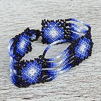 Glass beaded wristband bracelet, 'Northern Rain' - Hand Made Blue and Black Huichol Beaded Wristband Bracelet