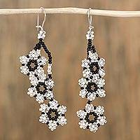 Glass beaded dangle earrings, 'Floral Gala' - Clear Glass Beaded Star Motif Earrings from Mexico