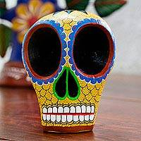 Wood skull figurine, 'Ancestral Image' - Hand Carved Wood Skull Figurine in Yellow from Mexico