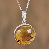 Amber pendant necklace, 'Honey Planet' - Circular Amber and Silver Pendant Necklace from Mexico