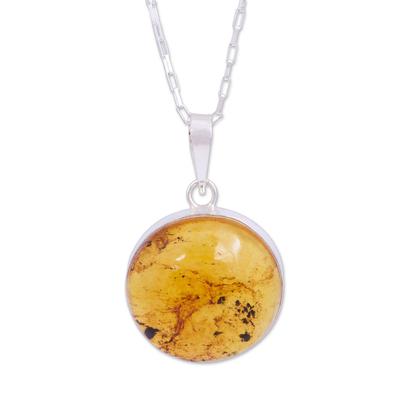 Amber pendant necklace, 'Honey Planet' - Circular Amber and Silver Pendant Necklace from Mexico