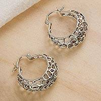 Sterling silver hoop earrings, 'Gleaming Pores' - Openwork Motif Sterling Silver Hoop Earrings from Mexico