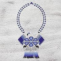 Glass beaded statement necklace, 'Blue Eagle' - Handcrafted Blue and White Eagle Beaded Statement Necklace