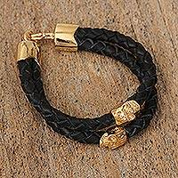 Gold accented leather pendant bracelet, 'Life and Death' - Black Double Strand Braided Leather Bracelet from Mexico