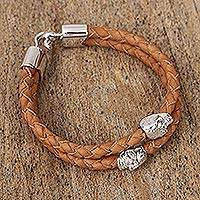 Braided leather pendant bracelet, 'Triumphant Life' - Hand Braided Leather Bracelet with Skull Accents from Mexico