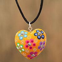 Wood pendant necklace, 'Cheerful Heart' - Multicolor Heart Shaped Wood Pendant Necklace