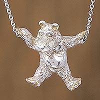 Gold accented sterling silver pendant necklace, 'Juggler Hippo' - Gold Accent Sterling Silver Hippo Necklace from Mexico