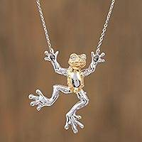 Gold accent sterling silver pendant necklace, 'Juggler Frog' - Gold Accent Sterling Silver Frog Necklace from Mexico