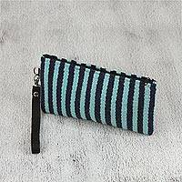 Leather accent Zapotec wool wristlet, 'Blue Stripes' - Handwoven Striped Wool Wristlet from Mexico