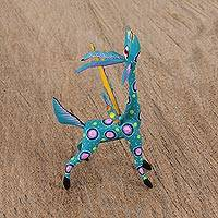Wood alebrije statuette, 'Winged Song' - Teal Alebrije Gazelle with Multicolor Hand Painted Motifs