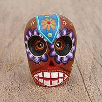 Wood figurine, 'Colorful Skull' - Hand-Painted Wood Skull Figurine from Mexico