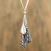 Ceramic pendant necklace, 'Raven Flowers' - Black and White Ceramic Sterling Silver Pendant Necklace