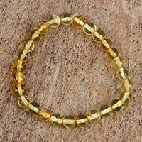Amber beaded stretch bracelet, 'Gleaming Sun' - Handcrafted Amber Beaded Stretch Bracelet from Mexico