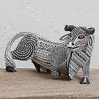 Wood alebrije sculpture, 'Resting Bull' - Wood Alebrije Bull Sculpture in Black and White from Mexico