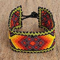 Glass beaded wristband bracelet, 'Huichol Passion' - Red and Orange Huichol Glass Beaded Wristband Bracelet