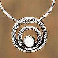 Sterling silver pendant necklace, 'Wheel of Time' - Circular Sterling Silver Pendant Necklace from Mexico