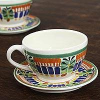 Ceramic teacups and saucers, 'Special Treat' (pair) - Hand-Painted Ceramic Teacups and Saucers from Mexico (Pair)