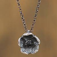 Sterling silver pendant necklace, 'Barro Negro Narcissus' - Sterling Silver and Ceramic Floral Necklace from Mexico