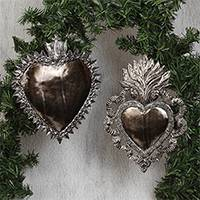 Tin wall sculptures, 'Impressive Hearts' (pair) - Religious Tin Heart Wall Sculptures from Mexico (Pair)
