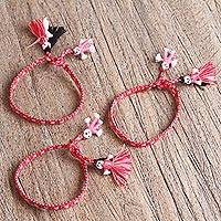 Cotton wristband bracelets, 'Passionate Dolls' (set of 3) - Cotton Wristband Bracelets in Rose and Tomato (Set of 3)