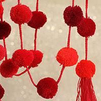 Cotton pompom garland, 'Festive Fruit Punch' - Handcrafted Shades of Red Cotton Pompom Garland from Mexico