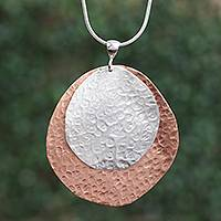 Sterling silver and copper pendant necklace, 'Rippling Eclipse' - Sterling Silver and Copper Pendant Necklace from Mexico