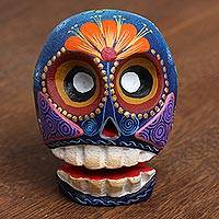 Wood figurine, 'Delightful Skull' - Vibrant Hand-Painted Copal Wood Skull Figurine from Mexico