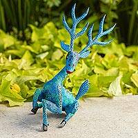 Wood alebrije sculpture, 'Resting Deer' - Hand-Painted Wood Alebrije Deer Sculpture in Blue